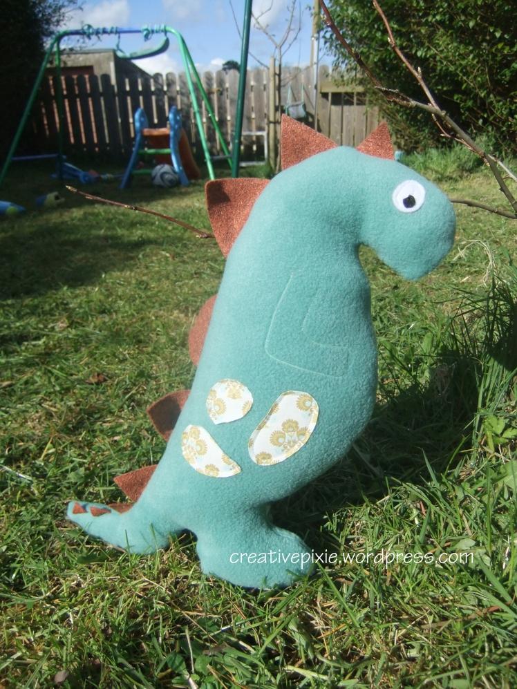 dinosaur on the grass web
