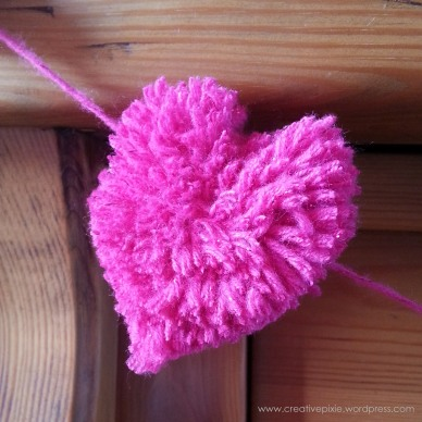 Creative Pixie heart pom pom close up