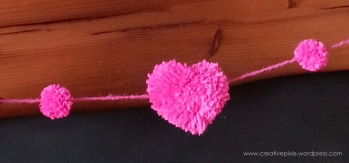Creative Pixie heart pom pom garland close up 2