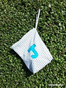 MIM appliqued shoe bag finished