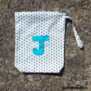 MIM appliqued shoe bag flat