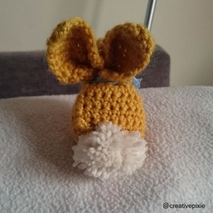 creative pixie crochet Easter bunny behind