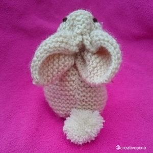 creative pixie knitted Easter bunny behind
