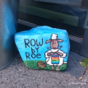 Row by Roe painted stone